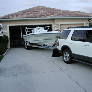 Son_backing_boat_into_garage_for_the_1st_time_4_19_2005_2.jpg